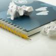 Crumpled papers and notebook — Stock Photo