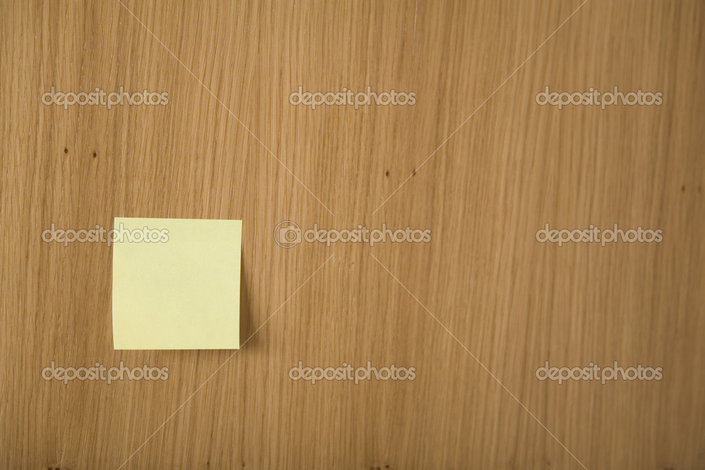 Yellow post it on wooden board — Stock Photo #3420596