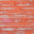 Red striped wooden with grunge paint — Stock Photo