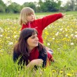Mother and daughter on a meadow — Stock Photo #3103535