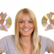 Pretty woman with two compact disks — Stock Photo #3826767