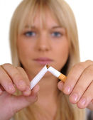 Woman breaks a cigarette — Stock Photo