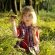 Little girl with mushrooms — Stock Photo #3890767
