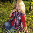 Little girl with mushrooms — Stock Photo #3890794