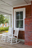 Two wood rocking chairs — Stock Photo