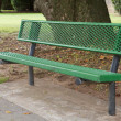 Green bench tree - Stock Photo
