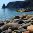 Sea stones on seacoast - Stock Photo