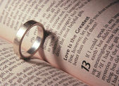 Wedding ring  on a bible — Stock Photo