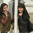 Two girls in pay phone — Stock Photo #2814468