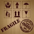 Royalty-Free Stock Vector Image: Wooden shipping box with fragile signs and stamp