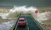 Car vs wave — Stock Photo