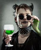 Goth-style man with absinthe glass photo — Stock Photo