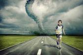 Tornado and running boy — Stock Photo