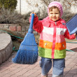 Little Girl with Broom and Trowel — Stock Photo