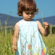 Little Girl Walking on Meadow — Stock Photo