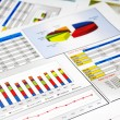 Sales Report in Statistics, Graphs and Charts - Stock Photo