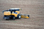 Aerial landscape with rural field and tractor — Stock Photo