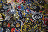Police and fireman badges — Stock Photo