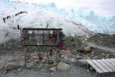 Crampons stand and glacier — Stock Photo