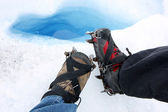 Crampons on legs — Stock Photo