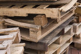 It is a shot of piles of wooden pallets — Foto Stock