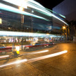 Bus speeding through night street. - Stock Photo