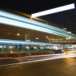 Bus speeding through night street. — Stock Photo