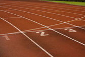 Running lanes on a track in play gorund — Stock Photo