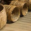 Baskets on wood floor — Stock Photo