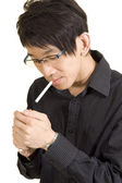 Young Asian man smoking — Stock Photo