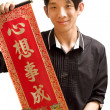 Young Asian man holding chinese lucky word for chinese new year — Stock Photo