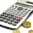 Calculator and coins — Stock Photo #3621128