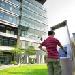 Royalty-Free Stock Photo: Asia boy play the touch screen in modern building outside