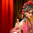 Chinese opera dummy and red cloth as text space - Stock Photo