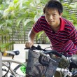 Asia man take bike in bicyle park — Stock Photo #3662984