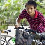 Asia man take bike in bicyle park — Stock Photo