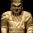 Chinese sculpture min black background — Stock Photo #3663007
