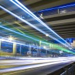 Stock Photo: Freeway in night with cars light in modern city.