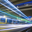 Freeway in night with cars light in modern city. - Foto de Stock