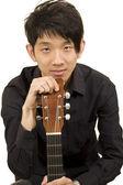 Asia boy plays his guitar — Stok fotoğraf