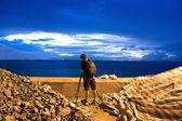 Photogrpher working at sunrise — Stock Photo