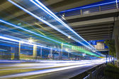 Freeway in night with cars light in modern city. — Foto Stock