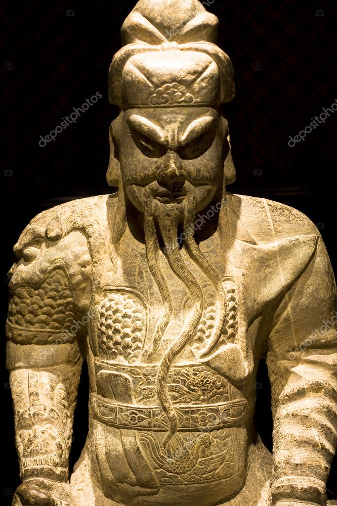 Chinese sculpture man in black background,it is toy  Stock Photo #3663007