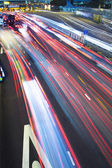 Traffic lights in motion blur — Stok fotoğraf