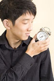 Concept of businessman with a clock on the shoulder — Stock Photo