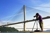 Man take photo of the bridge — Stock Photo