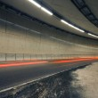 Car lights trails in a tunnel — Stock Photo