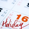 Hand writing holiday important date on calendar — Stock Photo