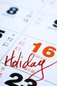Takvime tatil önemli bir tarih yazma el. — Stok fotoğraf