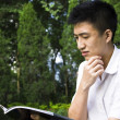 Young student reading books at the school park — Stock Photo #3890761